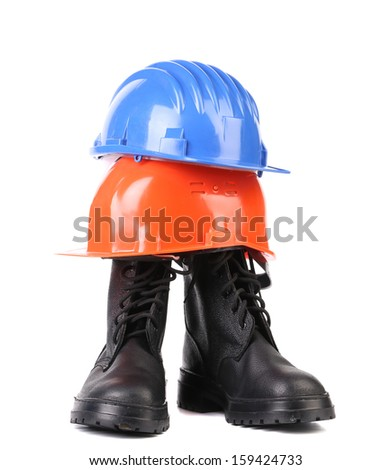 Hard hat and working boots. Isolated on a white backgropund. - stock photo