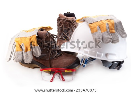 Hard hat, boots, gloves and glasses on a white background - stock photo
