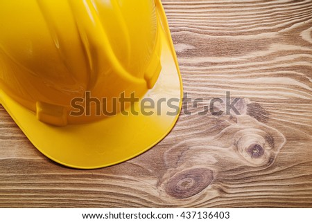 Hard hat on wooden board construction concept. - stock photo