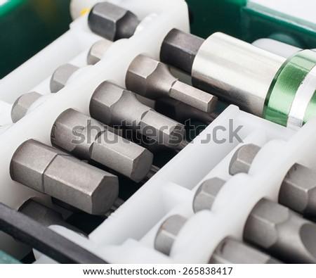 Hard metal tool bits collection close up - stock photo