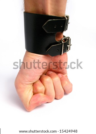 Hard punching hand with a black bracelet. - stock photo
