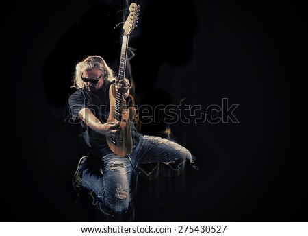 Hard rock heavy metal guitarist playing his instrument - stock photo