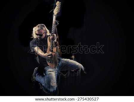 Hard rock heavy metal guitarist playing his instrument - stock photo