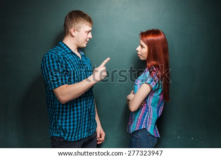 Hard times in relationship. Angry husband, boyfriend trying to explain something to annoyed wife, girlfriend. Marriage problems. Negative emotions. - stock photo