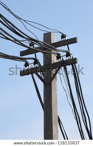 Hard wire on electric pole in blue sky. - stock photo
