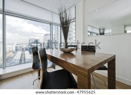 hard wood chunky dining table with chairs and decoration - stock photo
