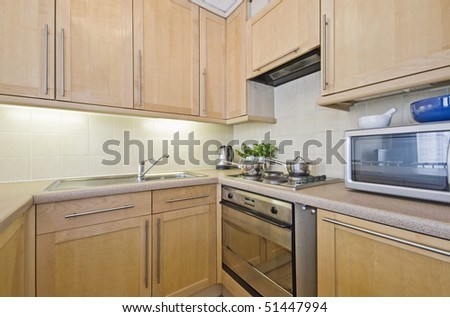 hard wood kitchen unit with accessory and herbs - stock photo