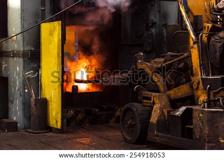 Hard work in a factory close up - stock photo