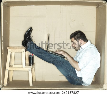hard work in uncomfortable office - stock photo
