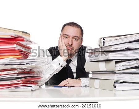 Hard working man in a office - stock photo
