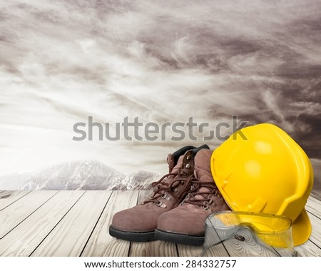 Hardhat, industrial clothes, goggles. - stock photo