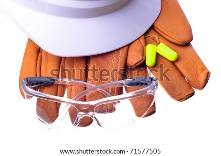 hardhat, safety glasses, gloves, and earplugs - stock photo