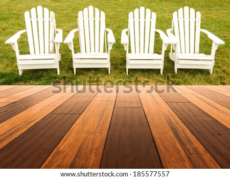 Hardwood floor in a room with Adirondack chair background - stock photo