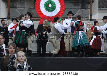 HARGHITA, ROMANIA - MARCH 15: Hungarian folk dancers at commemoration of 163nd anniversary of the Hungarian Revolution on March 15, 2011 in Harghita, Romania - stock photo