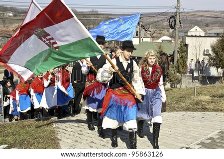 HARGHITA, ROMANIA - MARCH 15: Unidentified Hungarian people with folk costumes and flags at commemoration of 163nd anniversary of the Hungarian Revolution on March 15, 2011 in Hargita, Romania - stock photo