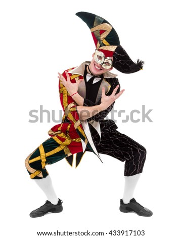 harlequin wearing a mask, isolated on white background in full length. - stock photo