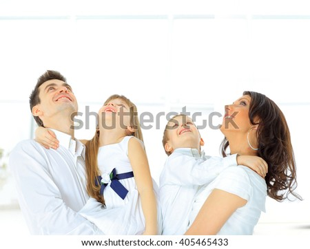 Harmonious family laying down and looking up - stock photo