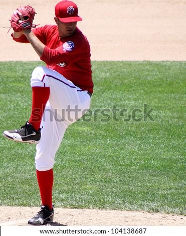 HARRISBURG, PA - MAY 31: Harrisburg Senators Rafael Martin throws  a pitch against the Portland Sea dogs at Metro Bank Park on May 31, 2012 in Harrisburg, PA. - stock photo