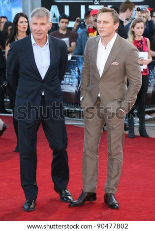 Harrison Ford and Daniel Craig arriving for the UK premiere of 'Cowboys & Aliens' at the O2, London. 11/08/2011  Picture by: Alexandra Glen / Featureflash - stock photo