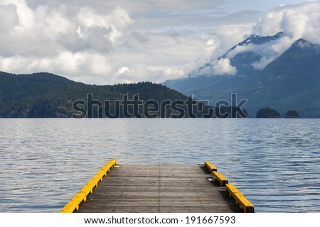Harrison Lake. Harrison Lake is the largest lake in the southern Coast Mountains of Canada, being about 250 square kilometres  in area. It is situated along the tourist area of Harrison Hot Springs. - stock photo