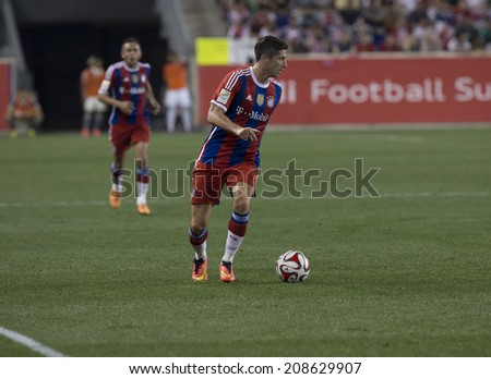 Harrison, NJ - JULY 31, 2014: Robert Lewandowski (9) of FC Bayern controls the ball during friendly match between CD Guadalajara Chivas and FC Bayern Munich at Red Bull Arena - stock photo