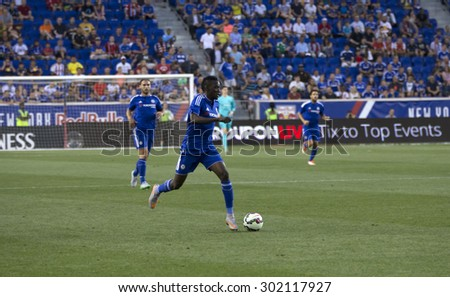 Harrison, NJ USA - July 22, 2015: Bertrand Traore (foreground) controls the ball during game between New York Red Bills and Chelsea FC at Red Bulls arena - stock photo