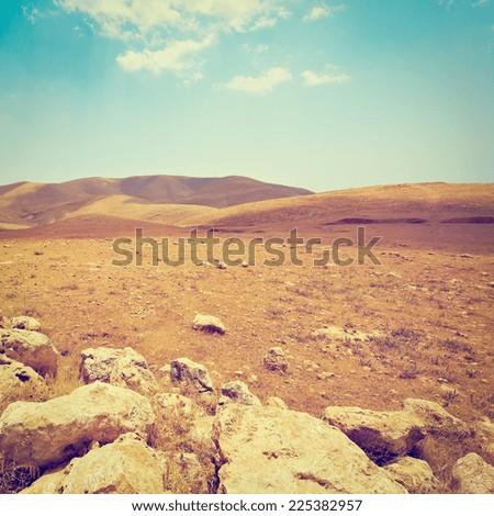 Harsh Mountainous Terrain in the West Bank, Israel, Instagram Effect - stock photo