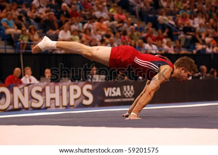 HARTFORD; CT - AUGUST 13: Gymnast Chris Brooks performs in the floor exercise during the men's competition at the VISA Nationals Gymnastics Championships in Hartford; CT on August 13, 2010. - stock photo