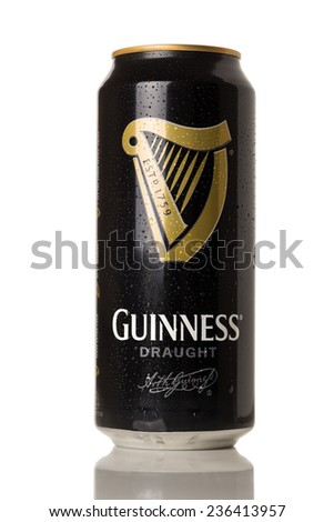 HARTLEPOOL, ENGLAND - DECEMBER 06, 2014: Guinness can on white background. Guinness is a popular Irish dry stout originated in the brewery of Arthur Guinness at St. James's Gate, Dublin in 1759. - stock photo
