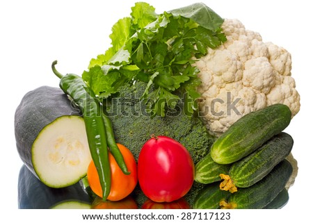 Harvest fresh vegetables on a mirror table - stock photo