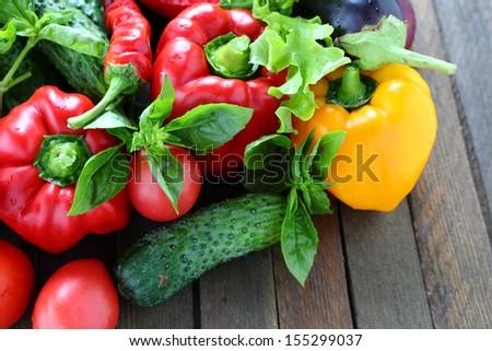 harvest of fresh vegetables on the table, pepper, tomato, basil, cucumber, tomato - stock photo