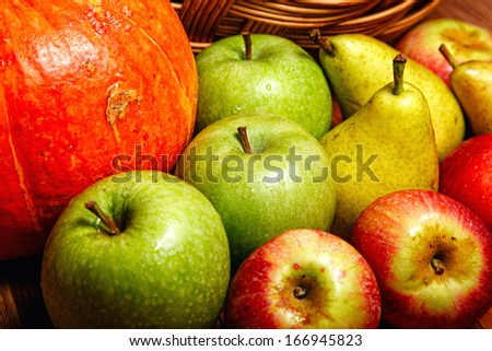 Harvest of ripe fruits and vegetables: apples, pears and pumpkin - stock photo
