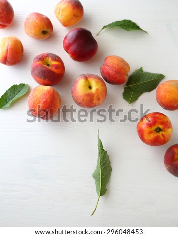 harvest of ripe peaches, top view - stock photo
