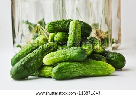 harvesting and canning cucumbers for winter - stock photo
