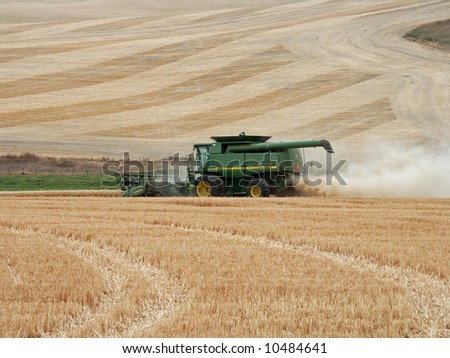 Harvesting wheat in a field in Idaho - stock photo