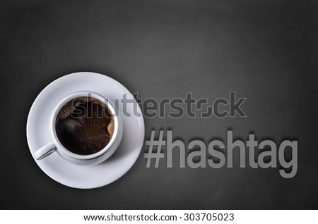 Hashtag word on blackboard with coffee cup - stock photo