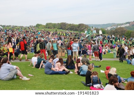 HASTINGS, ENGLAND - MAY 5, 2014: Crowds gather on the West Hill at the annual Jack In The Green festival. The traditional festival marks the May Day public holiday in Britain. - stock photo