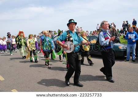 HASTINGS, ENGLAND - MAY 5, 2014: Musicians perform during the parade on the West Hill at the annual Jack In The Green festival. The event marks the May Day public holiday. - stock photo