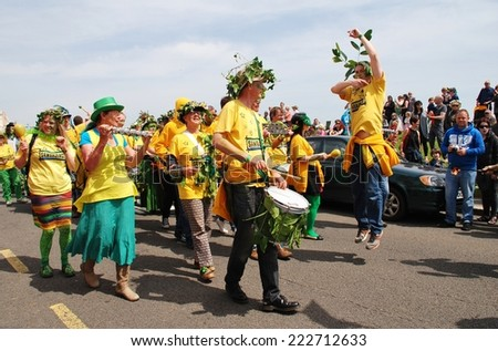 HASTINGS, ENGLAND - MAY 5, 2014: The Sambalanco samba band perform during a parade on the West Hill at the annual Jack In The Green festival. The festival marks the May Day public holiday in Britain. - stock photo