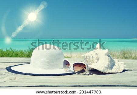 Hat and sunglasses. Exuma, Bahamas - stock photo