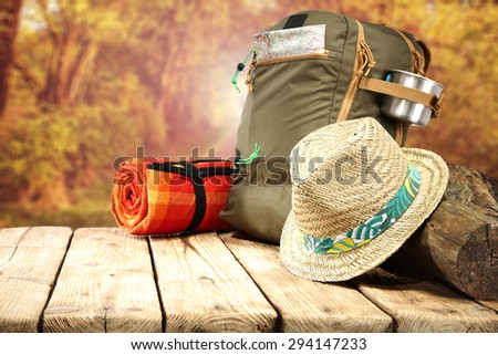 hat backpack and wooden top  - stock photo