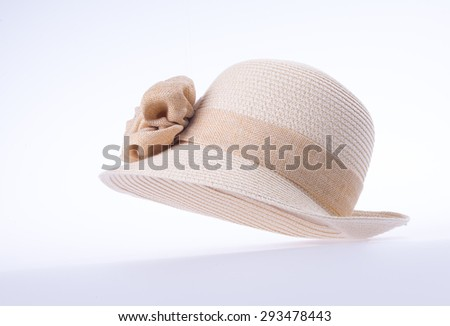 hat for lady or pretty straw hat with flower - stock photo