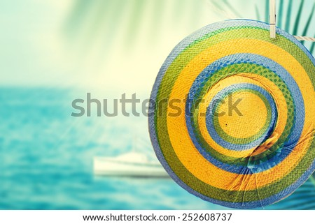 Hat from the sun hanging on a rope on sea background. Vacation concept. - stock photo