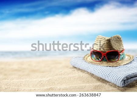 hat glasses and towel  - stock photo