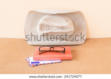 Hat,notebook, glasses and envelope on wood background - stock photo