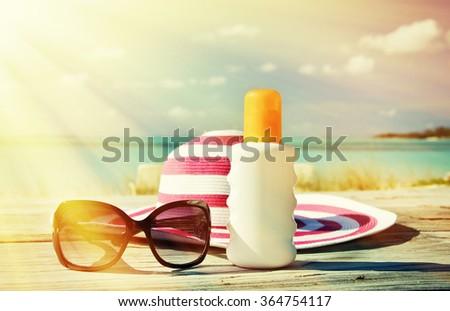 Hat, sunglasses and sun lotion. Exuma, Bahamas - stock photo