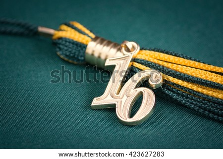 Hat tassel with the graduating year 2016 - stock photo