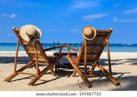 hats on beach chairs of tropical sand beach in Boracay, Philippines - stock photo