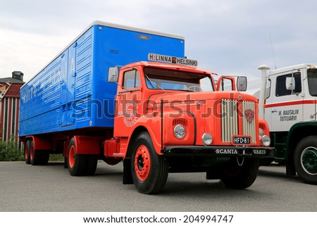 HATTULA, FINLAND - JULY 12, 2014: Classic Scania Vabis 75 semi trailer truck on display at Tawastia Truck Weekend in Hattula, Finland. Scania Vabis 75 was manufactured between 1958-1963. - stock photo