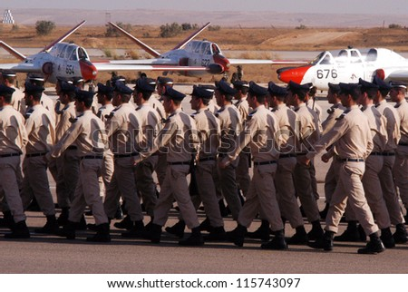 HATZERIM - JUNE 28:Newly graduated Israeli Air Force pilots march in formation during their graduation ceremony at the Hatzerim Air Force base near Beer Sheva Israel, on June 28, 2007. - stock photo